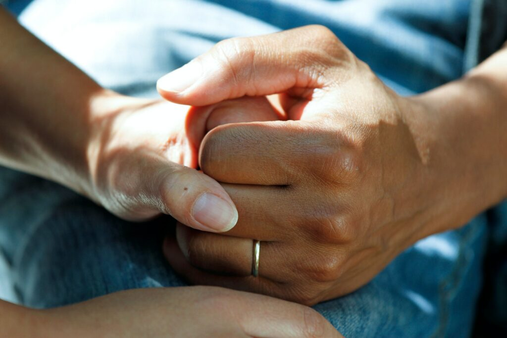 Photograph of a carer holding a hand to show an aspect of home care in the Colne Valley Huddersfield Kirklees